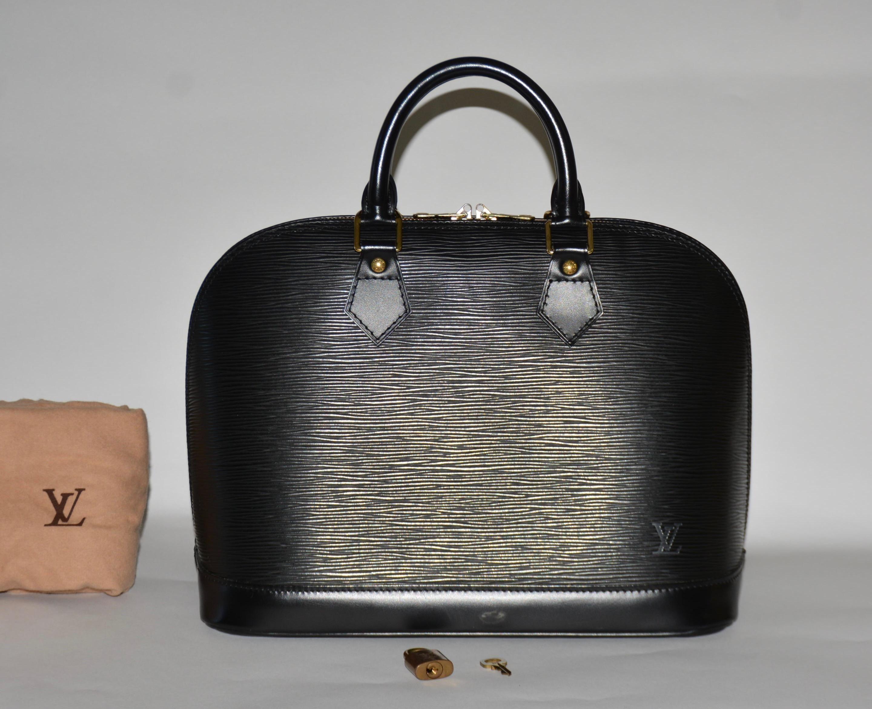f2f6c953ec78 Louis Vuitton Epi Alma Pm Black Satchel. Save 70% on the Louis Vuitton Epi  Alma Pm Black Satchel! This satchel is a top 10 member favorite on Tradesy.