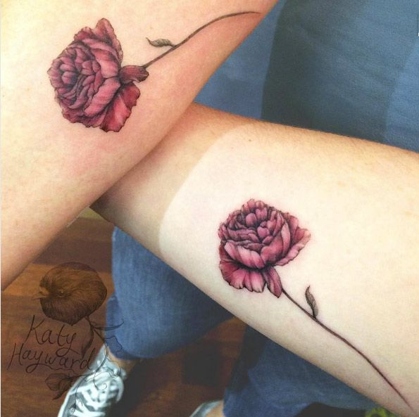 Matching red roses by Katy Hayward