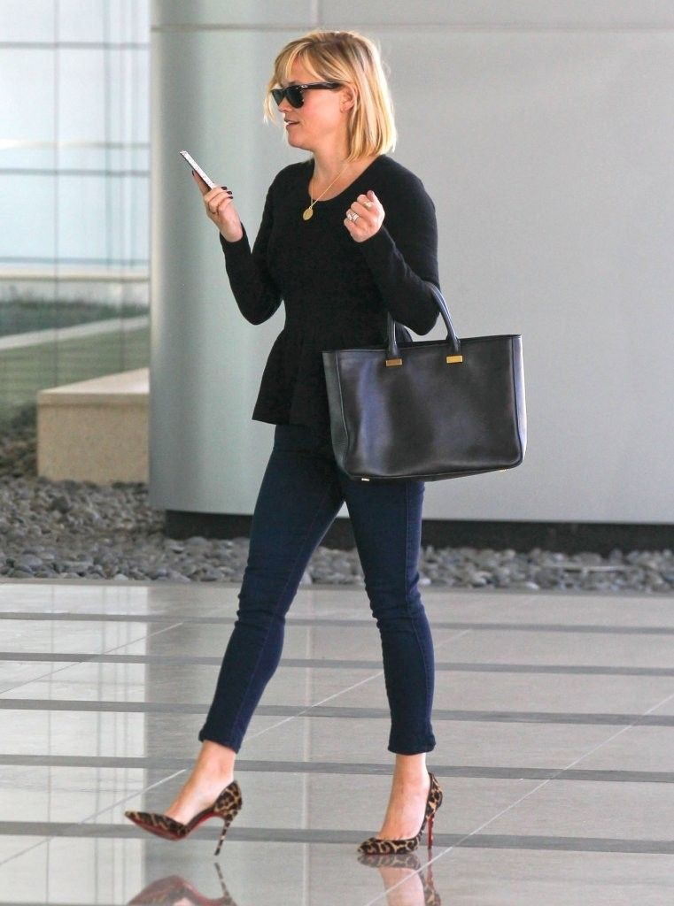 Reese Witherspoon wearing The Row Small Day Luxe Leather Tote Christian Louboutin Iriza Leopard-Print Calf Hair Red Sole Pump