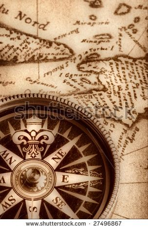Compass on old handwritten map