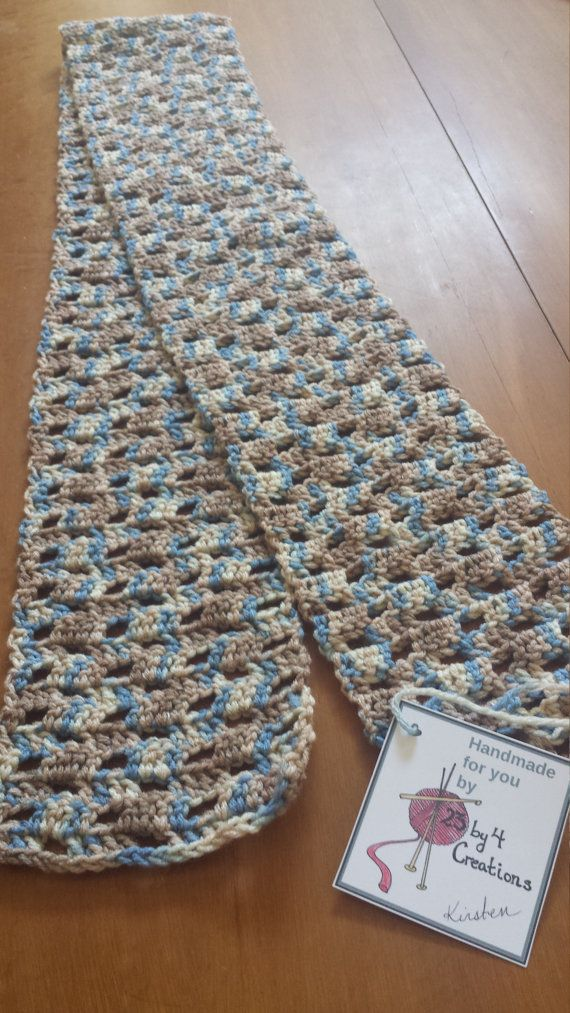The colors in this scarf remind me of the tundra (yellow-brown grasses and blue skies with loads of wildlife scampering about). I crocheted this