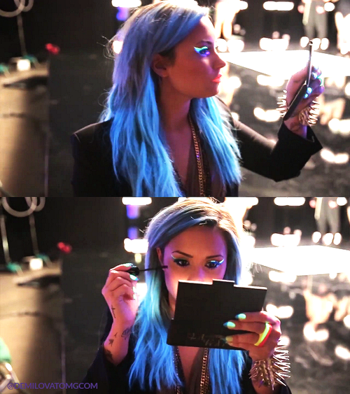 me on March 1st, 2014 doing my black light makeup for Demi ...