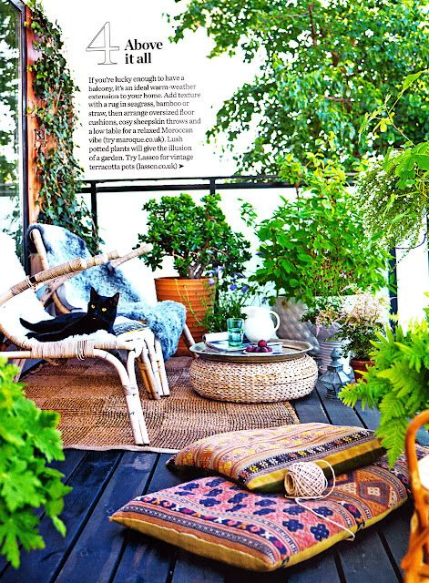 Deck Outside Of Guest House Plants And Woven Outdoor Rug With