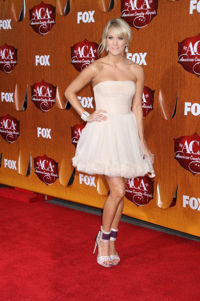 Singer Carrie Underwood wore a Maria Lucia Hohan dress to the American Country Awards 2011 at the MGM Grand Garden Arena on 5 December 2011 in Las Vegas, Nevada