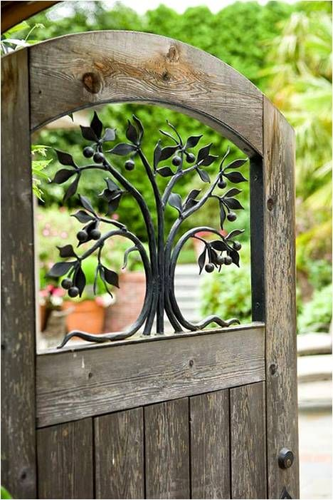 Worn Wood Garden Gate with Ironwork Tree