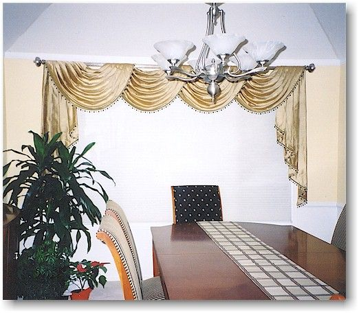 Here is a pole swag in silk with beaded trim on a rod that matches the chandelier.
