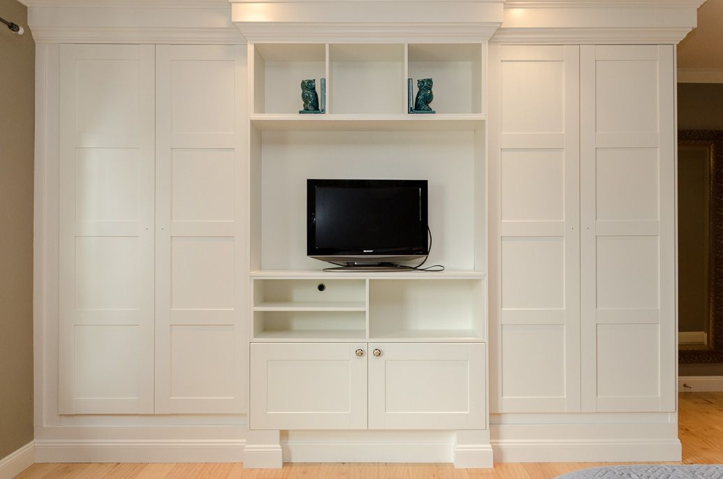 Using IKEAs PAX closet system we were able to make these stylish