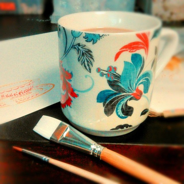 Watercolor painting in progress of a tea cup. Illustration, art, coffee, orange, blue. By Shalom Schultz Designs.