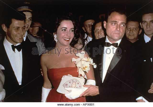 ELIZABETH TAYLOR with fourth husband Eddie Fisher left and third husband Mike Todd - Stock Image