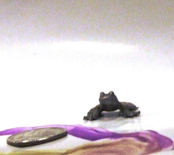 A Mini Hippity Hoppity Pewter Frog by KoliopeeDesigns on Etsy, $9.99