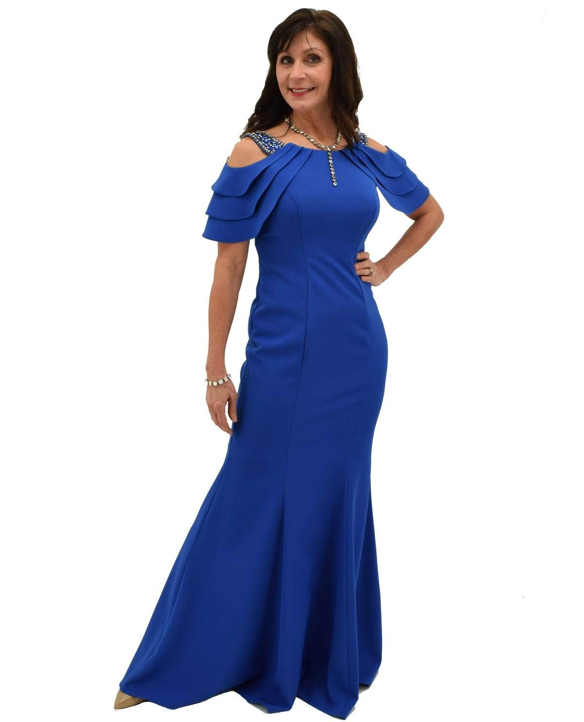 fb5dae91842b7 This dazzling sapphire blue gown has rhinestones along the shoulders for  your son or daughter's special day! #motherofthebridedresses  #motherofthebride ...