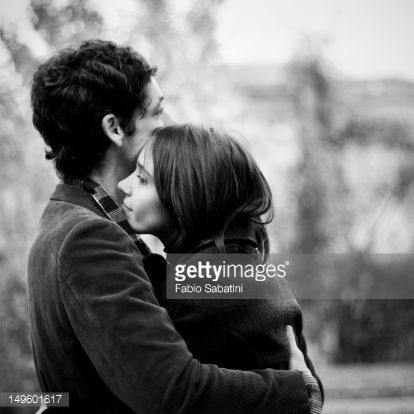 Couple Hugging Stock Photo   Getty Images. Couple hugging in public park    Photos  Photography and Stock photos
