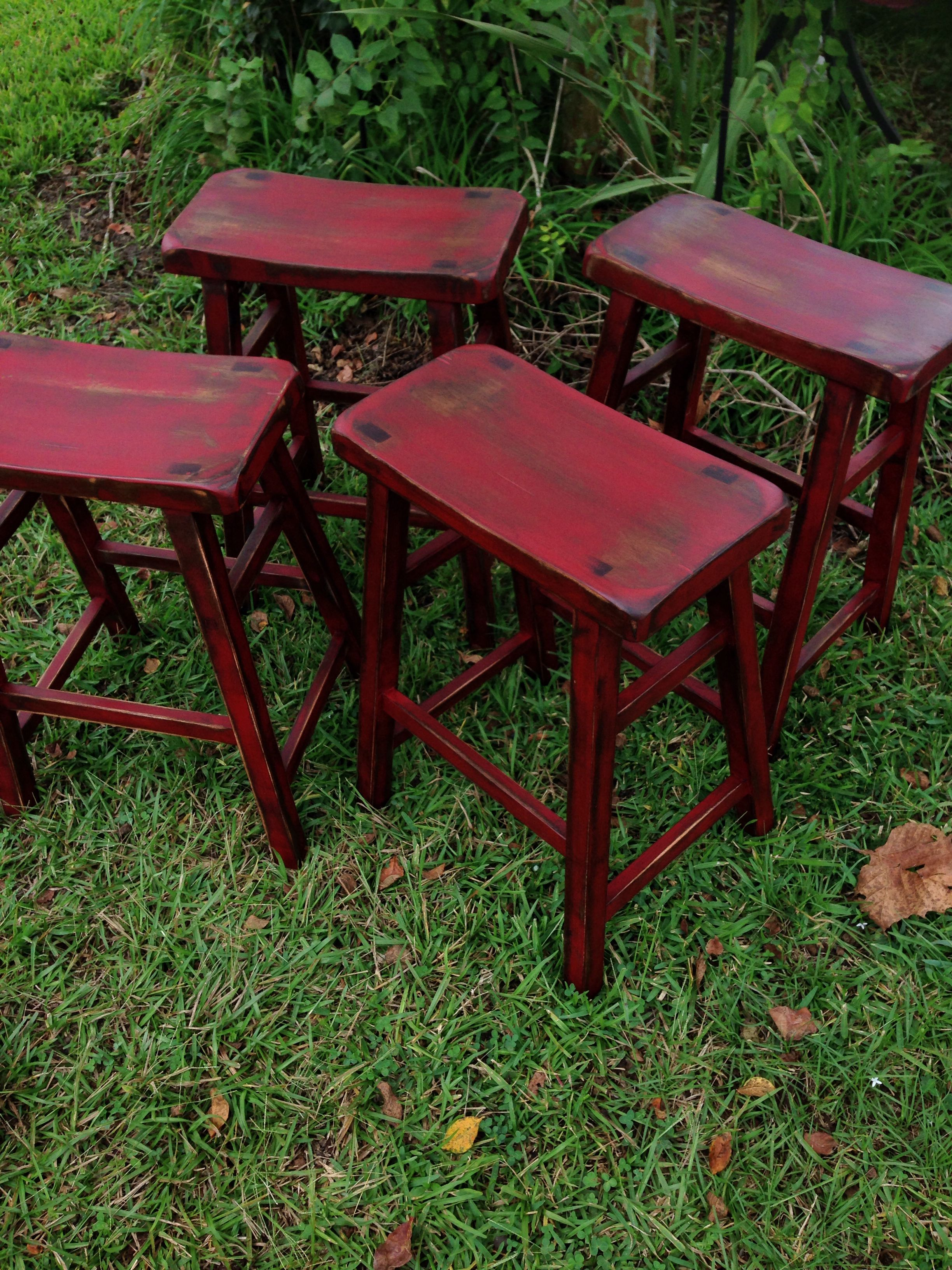 Barstools painted in a barn red color and distressed and ...