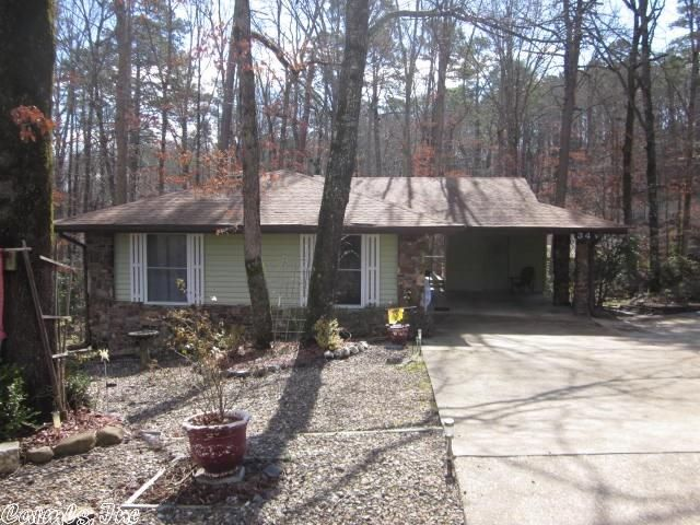 Great starter home / vacation or would make a great Rental .Vinyl Sided. Gutters and Gutter guards. Newer roof. Sun Tube 3 Skylights.( 2 ) 8 ft sliding Door windows Leads you onto a large deck. Large slab storage / Work room under home. Low mainentance Exterior in Hot Springs Village AR