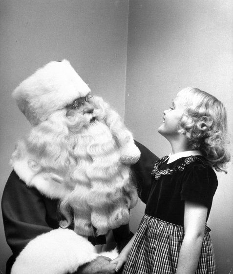Santa Claus with a young girl, 1948.