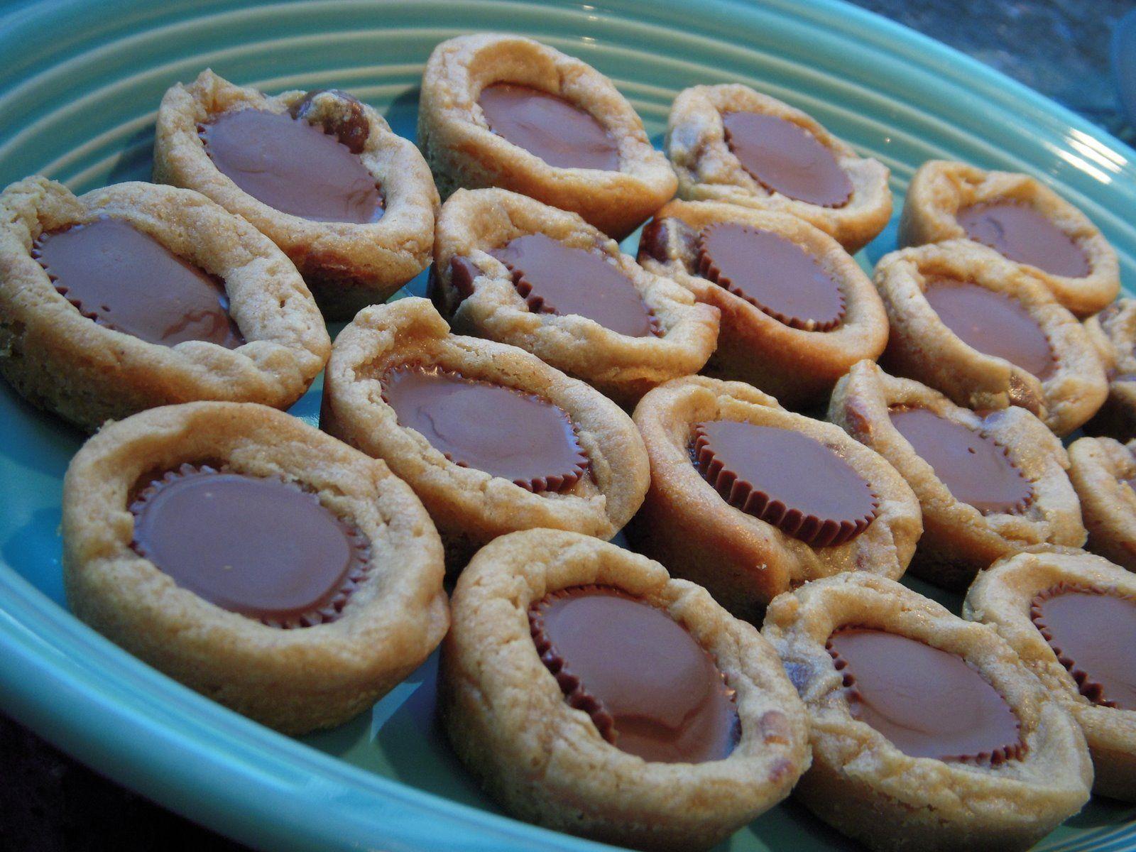 PB Cookie Dough for 12...break in half...bake 5 min less than package...press Resse's Mini's inside.