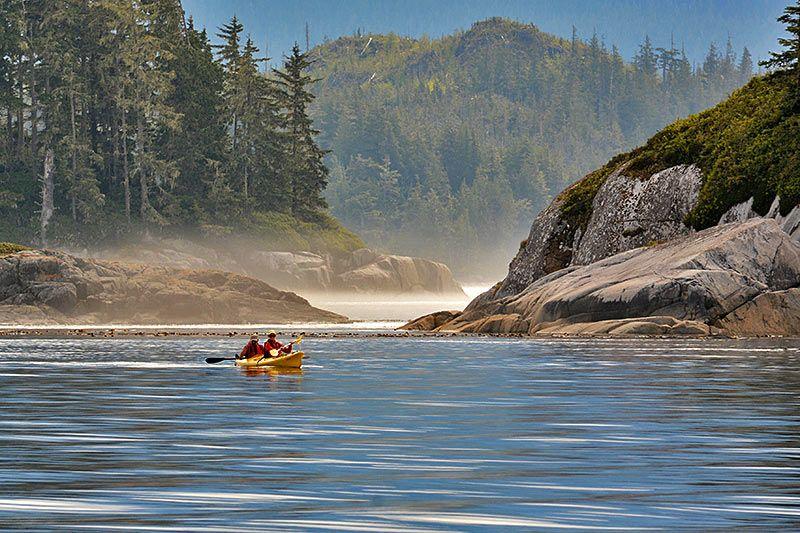 Kayakers paddling the coastal wilderness Orca Dreams