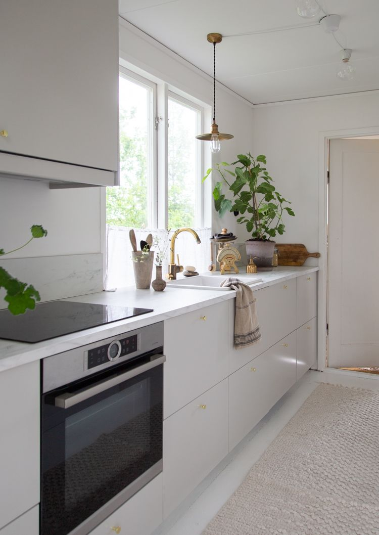 my scandinavian home: My Summer Cottage Kitchen Final Reveal (+ Get The Look)! white and grey kitchen with brass fittings. #greykitchendesigns
