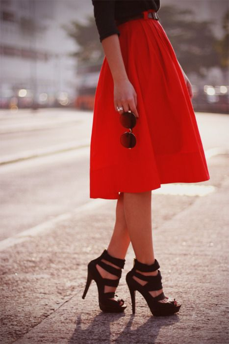 Lovely red skirt, sunglasses and black high heels.