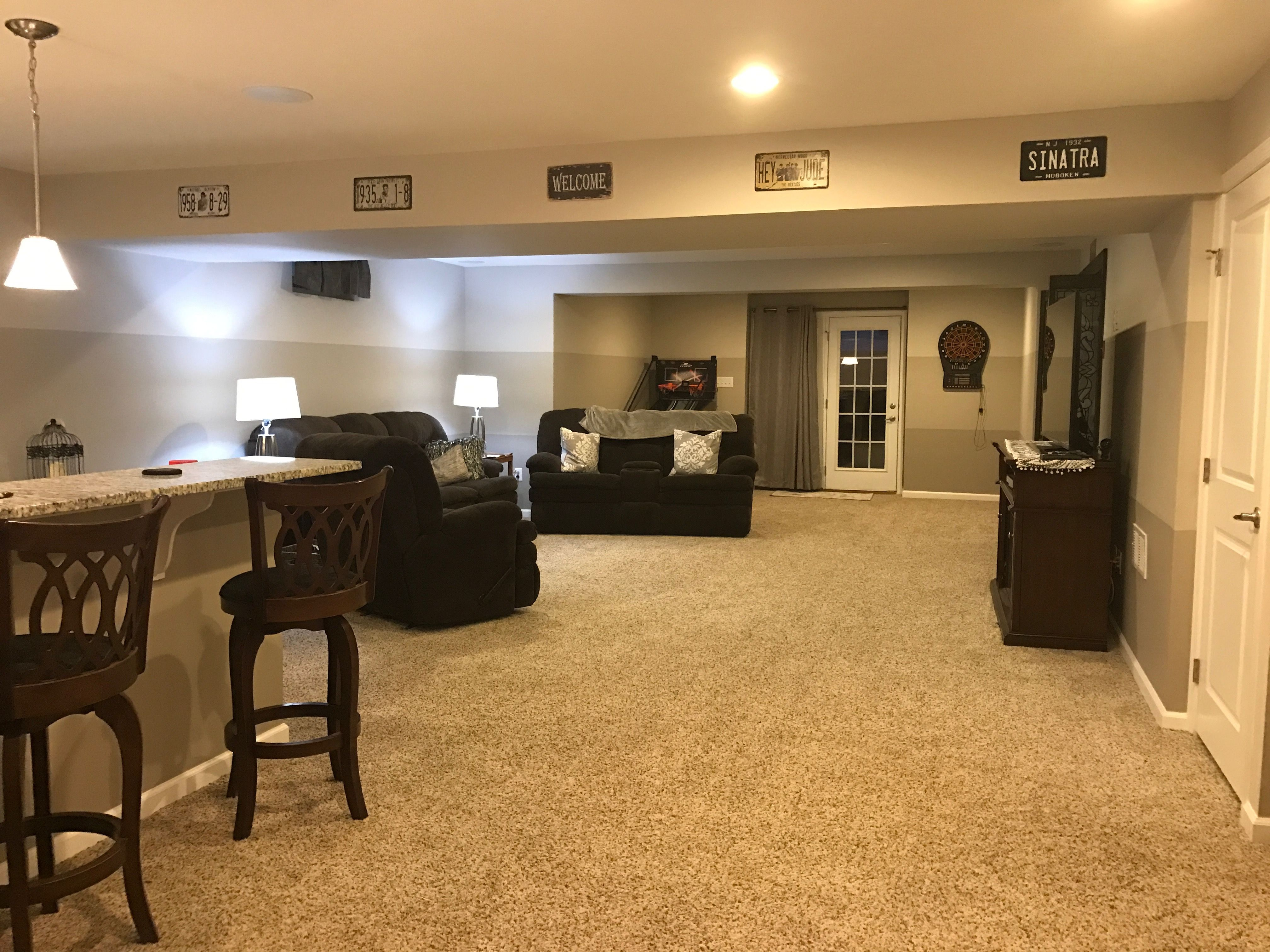 Ryan homes Rome model finished basement with bar and walk out. Stripes are  sherwin williams