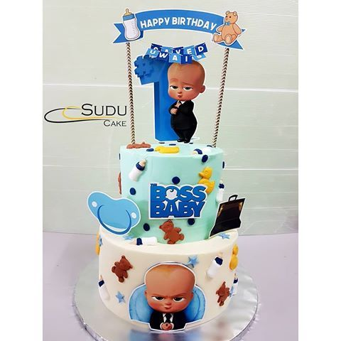2 tier stacked cake with boss baby theme. Happy birthday ...