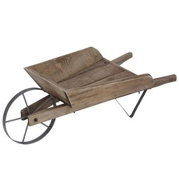 Make An Eye Catching Centre Piece In Your Garden With This Shabby Chic Wooden Wheelbarrow Herb Planter Wooden Wheelbarrow Wheelbarrow Wooden Garden Ornaments