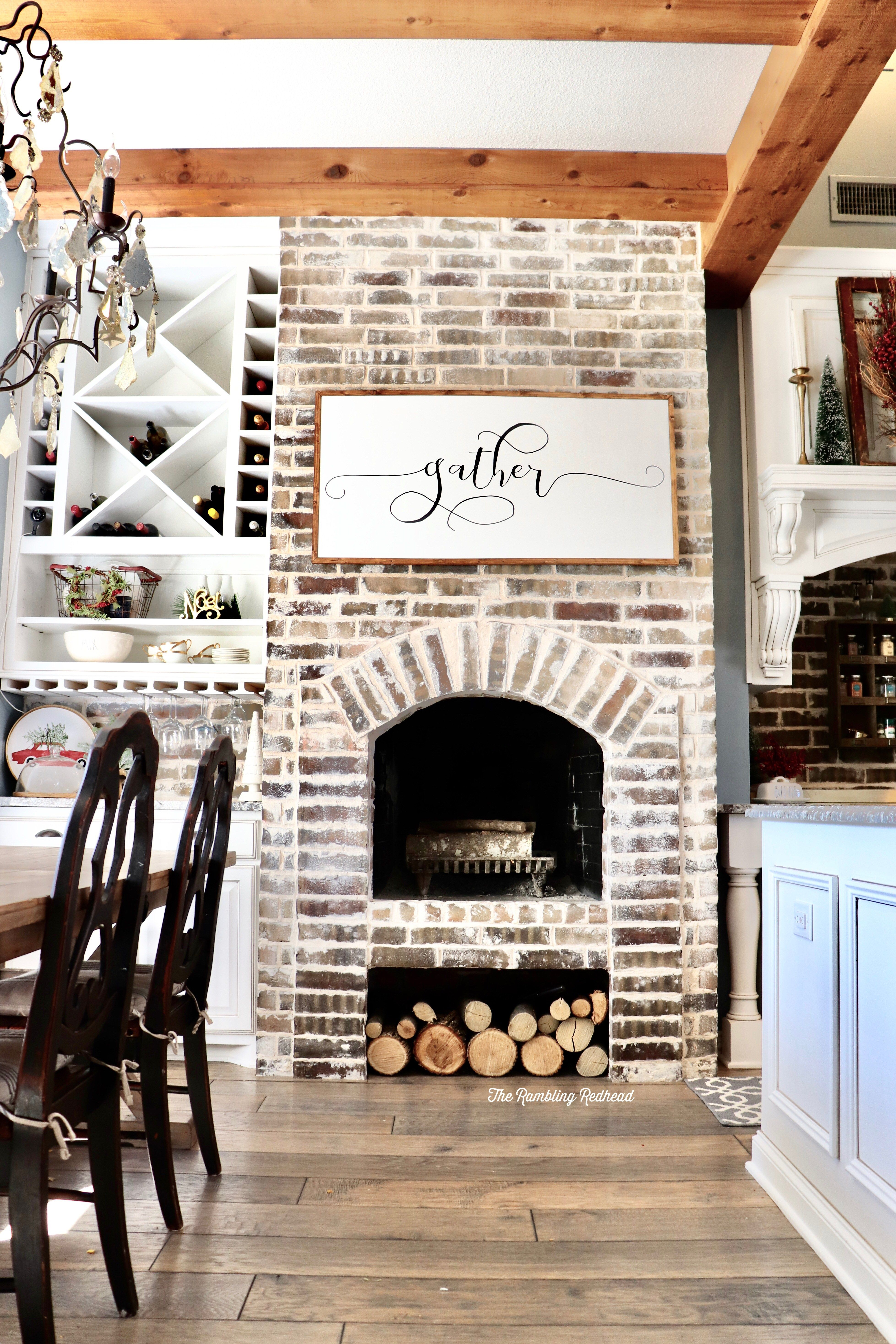 White washed brick arched fireplace in kitchen love this
