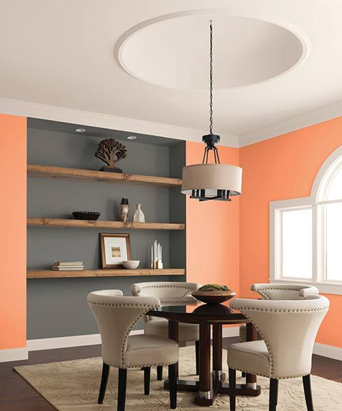 A Juicy Wall Color And Rustic Shelves Lighten The Mood In This Formal Setting