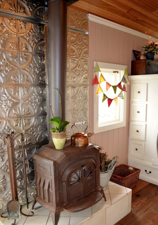 One of the most striking features in the home is its cast iron stove, which is supported by repurposed wheel wells.