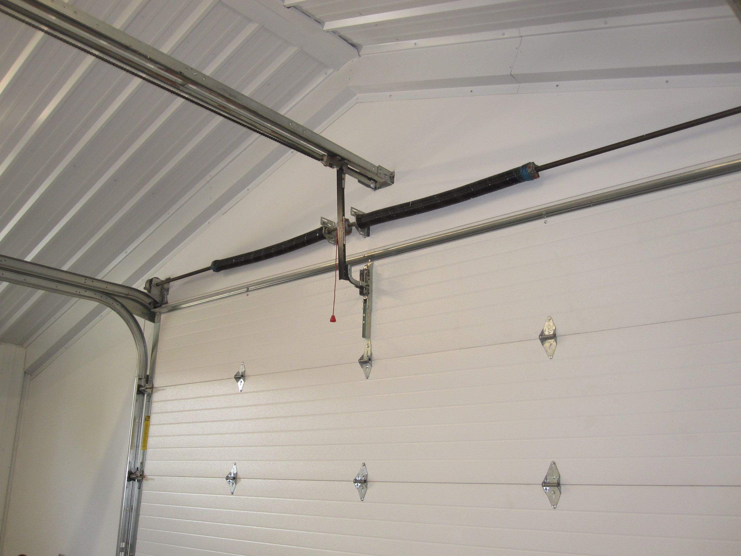 Garage Door Low Headroom Call Metal Building Outlet At 1 800 486 8415 To Learn More About Overhead Metal Shop Building Metal Garage Doors Metal Building Kits