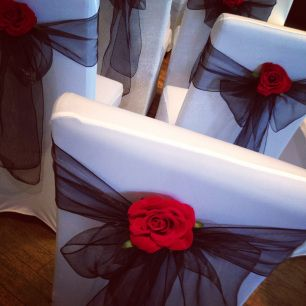 Black chair bow with red rose chair cover hire wedding decor and black chair bow with red rose chair cover hire wedding decor and centrepieces from junglespirit Images