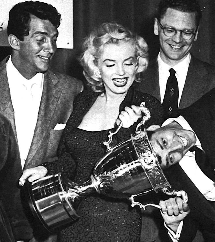 """Marilyn receives the Redbook Award in March of 1953 as the """"Best Young Box Office Personality."""" With her are Dean Martin, Redbook editor Wade Nichols, and Jerry Lewis"""