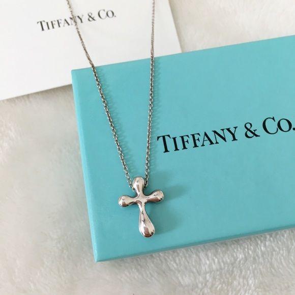274fcc06b Tiffany & Co Elsa Peretti Cross Necklace Silver Tiffany and Co cross  necklace in sterling silver. Chain is slightly tarnished, otherwise in  great condition.