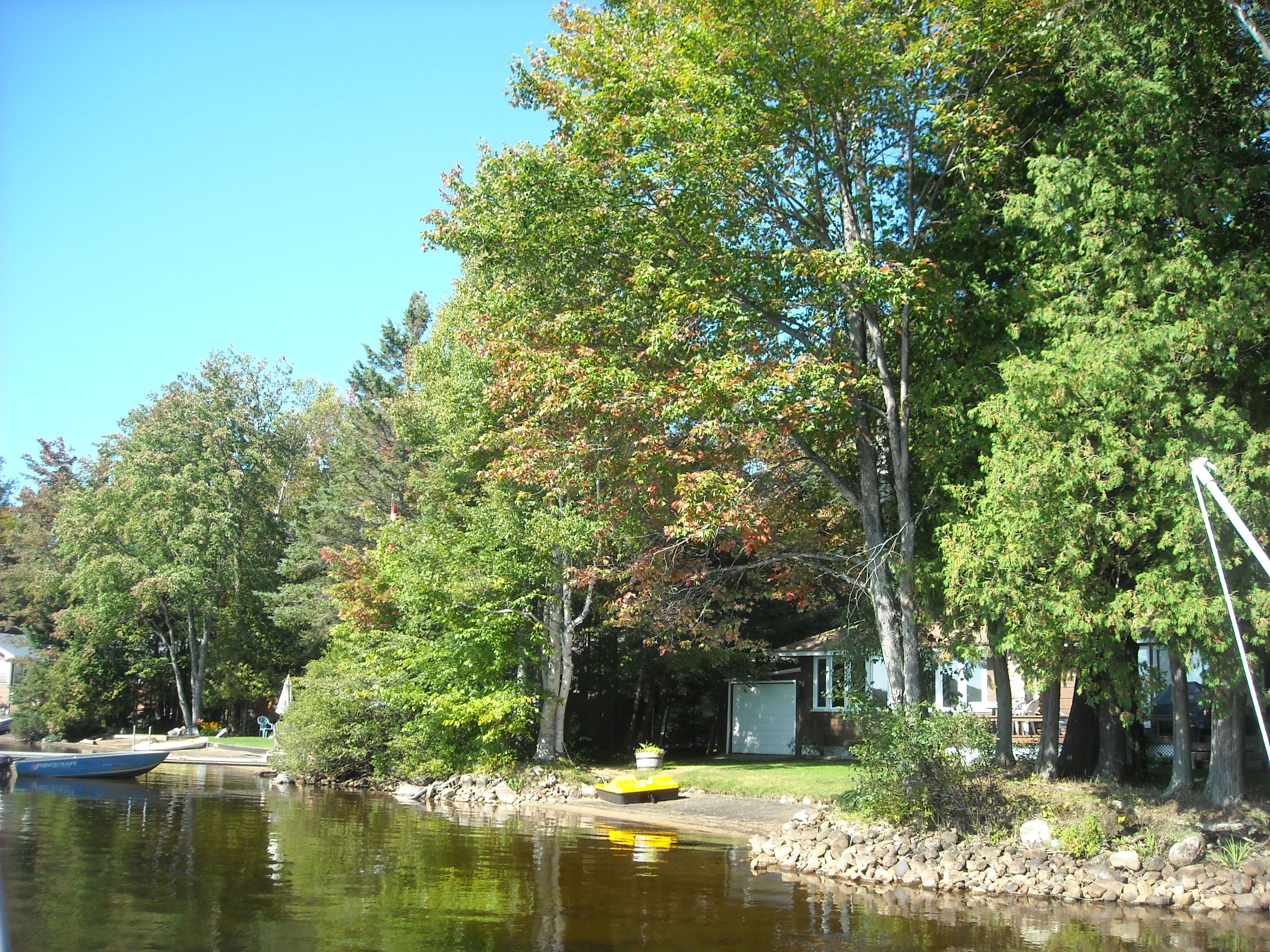 cottage roofedaccommodation rusticcabins bonnechere at accommodation rentals riverwatch cabin ontario cottages parks exterior wasaga cabins rustic beach roofed