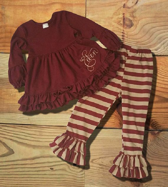 e3643ed70827a The burgundy & cream striped ruffled girls boutique outfit is high quality  and so trendy. The top is solid burgundy in color with tons of adorable  ruffles.