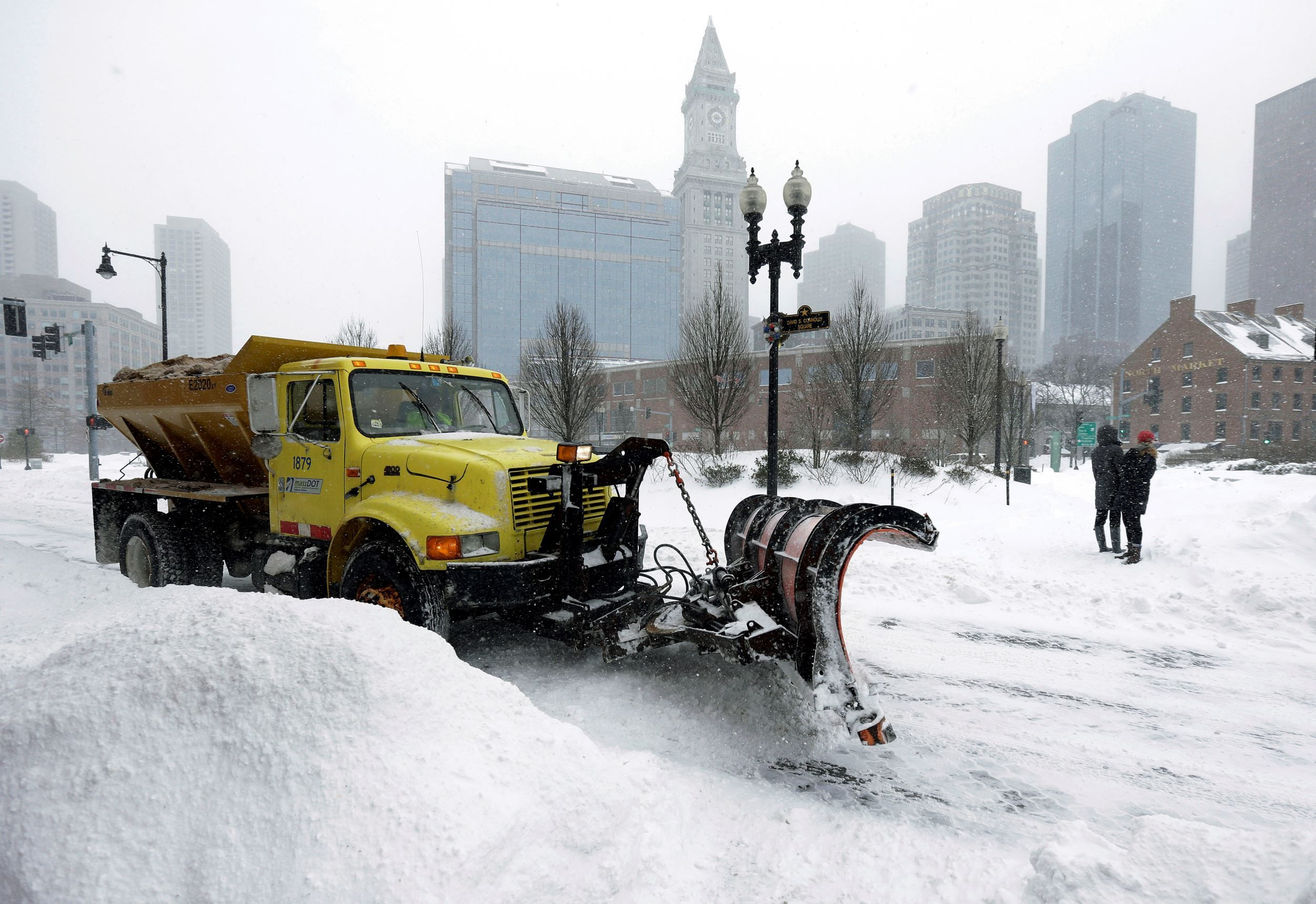 A snowplow clears a street near Quincy Market, Tuesday