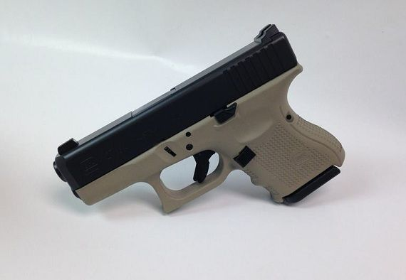 This Is A Glock 27 Gen4 With Night Sights Extended Slide Release