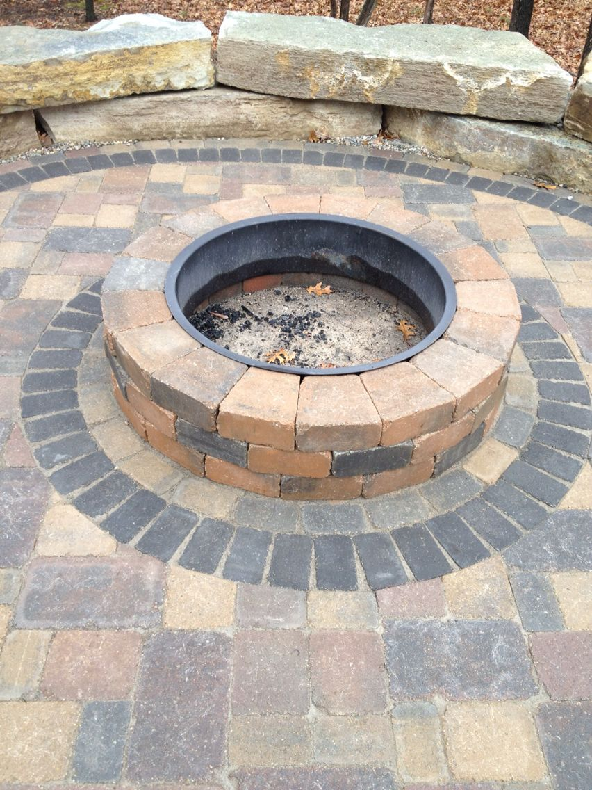 Fire Pit With Tumbled Brick Pavers And Black Accent Brick Circle Designed And Installed In Howell Michigan By Frank Sp Paver Stone Patio Fire Pit Patio Stones