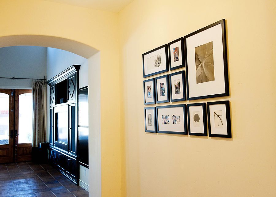 great photo display! To keep frames hanging straight (even after ...