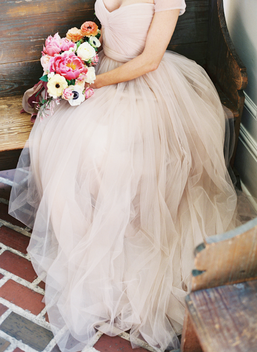 I'm traditional and would want this in white. Love how the tulle just falls.