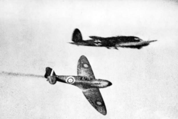 A Royal Air Force Supermarine Spitfire trails smoke after attacking a German Heinkel He 111H/P bomber during the Battle of Britain.