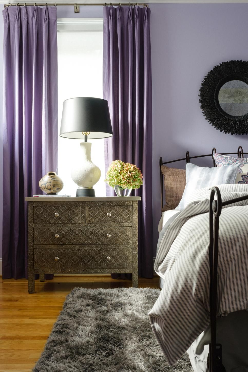 To Anchor The Light Lavender Walls, Black Touches Were Added In The Form Of  Paper Lampshades, An Iron Sleigh Bed And A Coconut Shell Mirror.