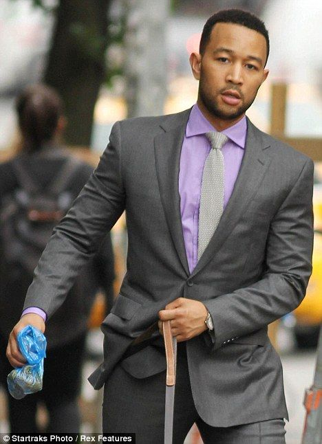 John Legend goes on dog walk in his red carpet suit... and picks ...
