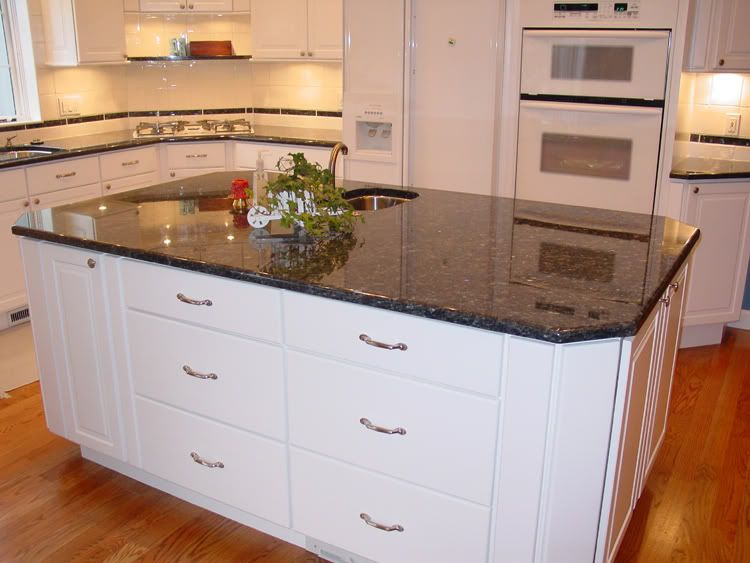 Beautiful Wood Carvings Including Under Counter Corbels With Custom Range Hood Sapphire Blue Granite Over White Cabinets