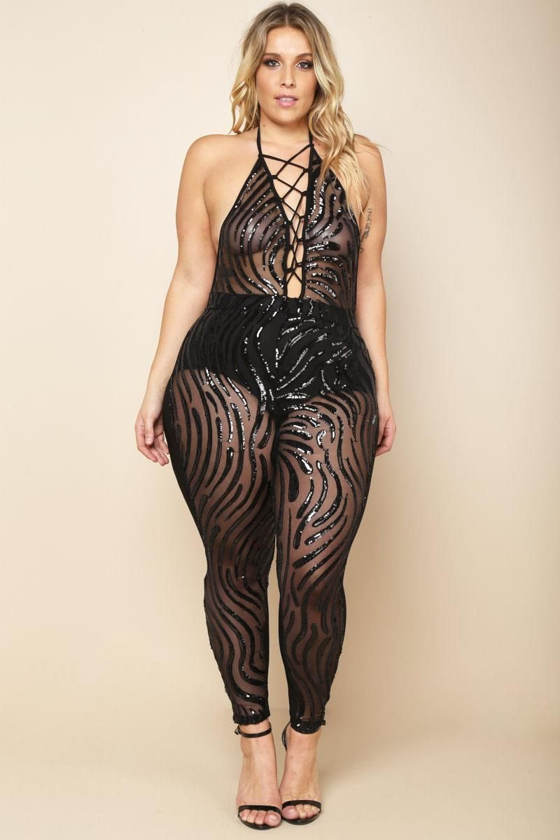 015d69a2f5a A plus size sleeveless jumpsuit with a lace up halter .