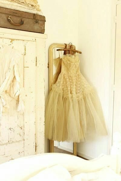 Hanging a beautiful vintage dress for décor.  Love this idea!