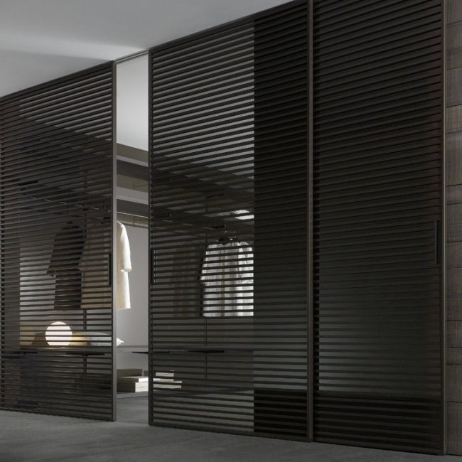 Modern Walk In Dressing Room With Black Semi Transparent Sliding