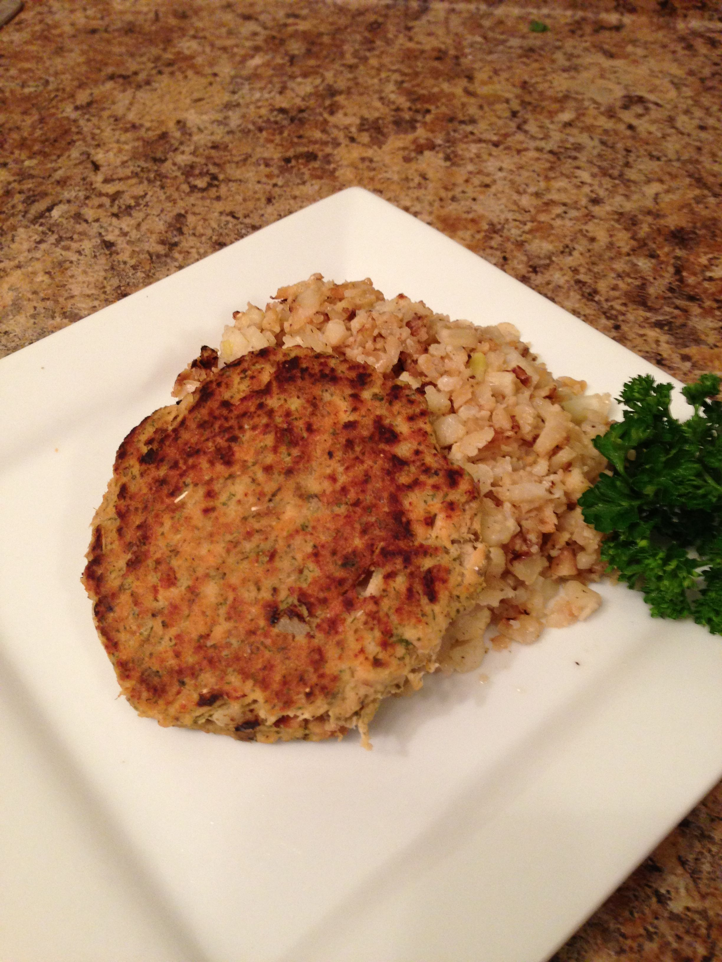 Paleo Salmon Cakes over Cauliflower Fried Rice...check out her blog!