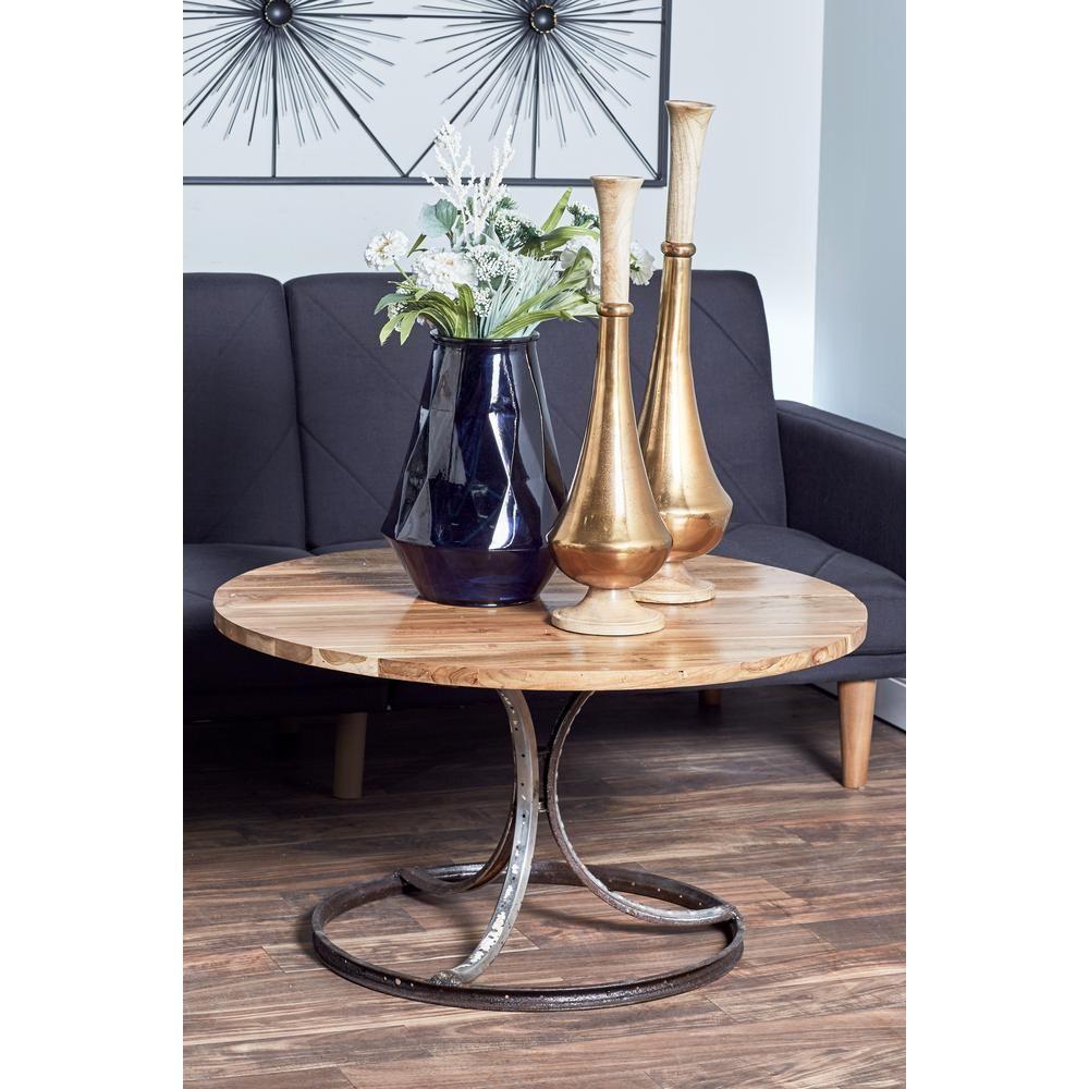 - Litton Lane Brown Round Coffee Table With Black Body 75597 Round