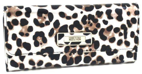 Kenneth Cole Reaction Silver Leopard Tri Me A River Wallet Kenneth Cole REACTION. $24.99. Two slip pockets, six card slots, clear ID window, zip coin pocket. Magnetic closure and back zip pocket. Trendy patent leopard print